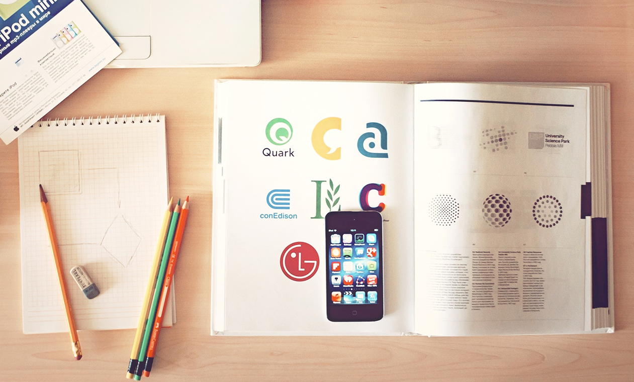design-textbook-pencils-notepad-iphone