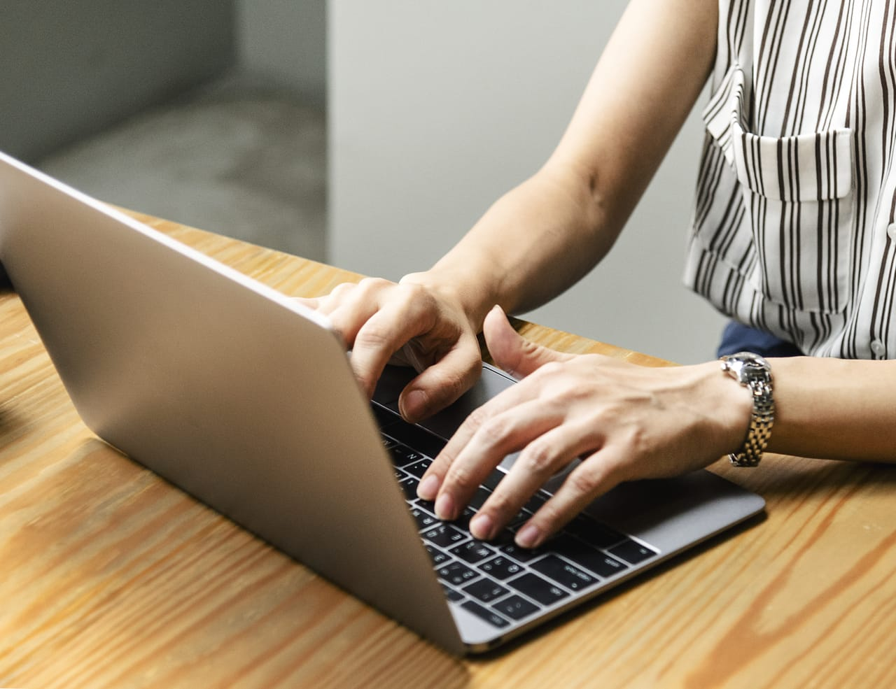woman-typing-on-laptop-computer